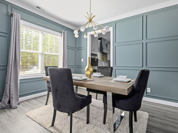 designer home dining room with wainscoting