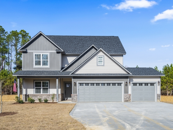 2 story home with front load 2 car garage and optional 1 car garage add-on